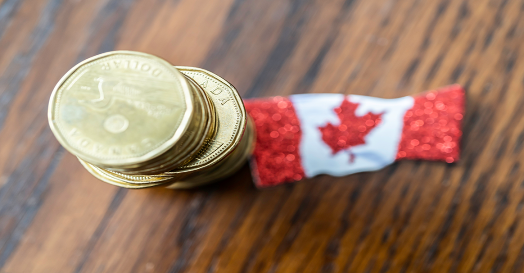 loonie stack and canadian flag
