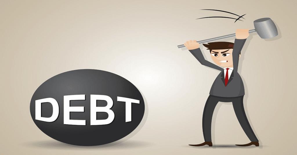 Man smashing debt ball
