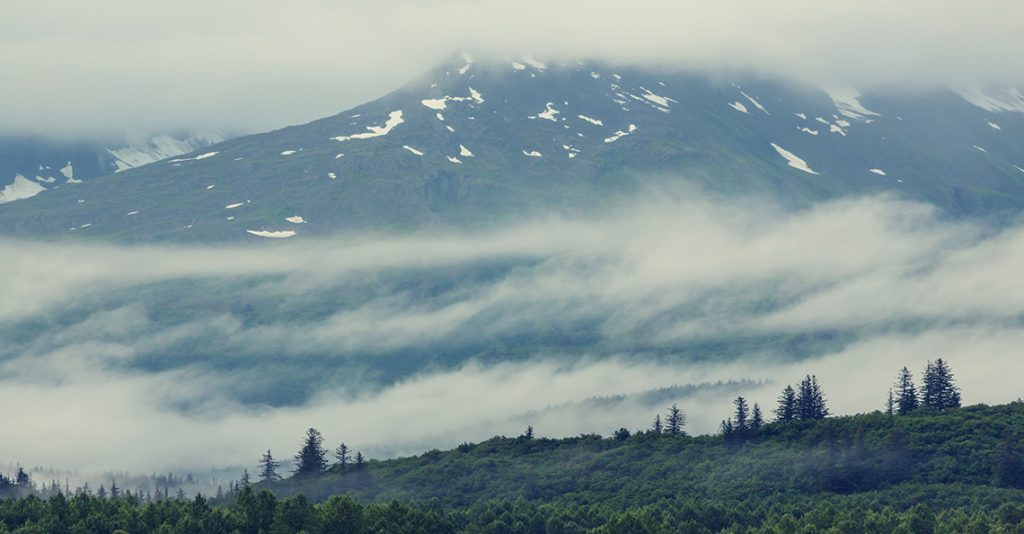 Alaskan mountains in the clouds