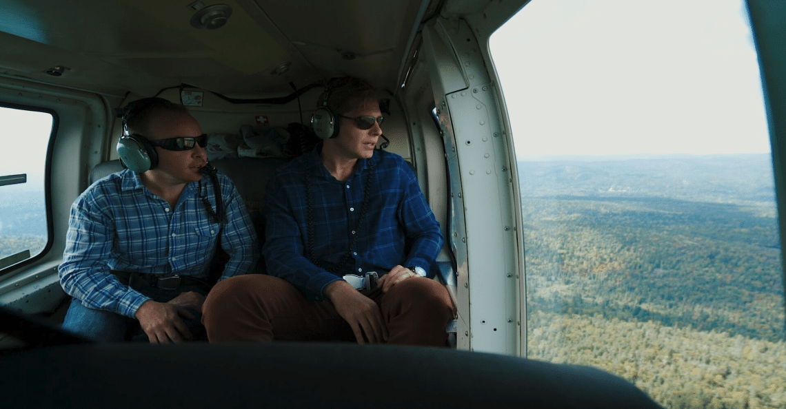 Alex and Gord look at Wire Lake Gold System from the air