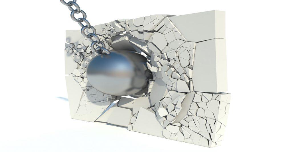 ball breaking through brick wall