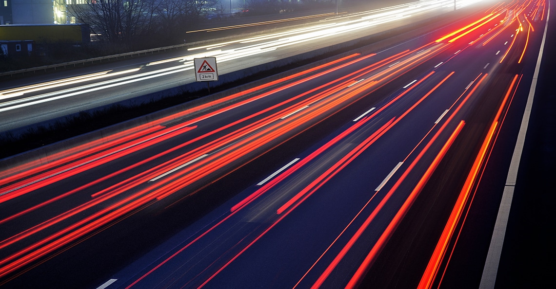 blurred cars moving fast on a highway