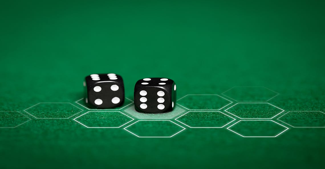 dice on green electronic table