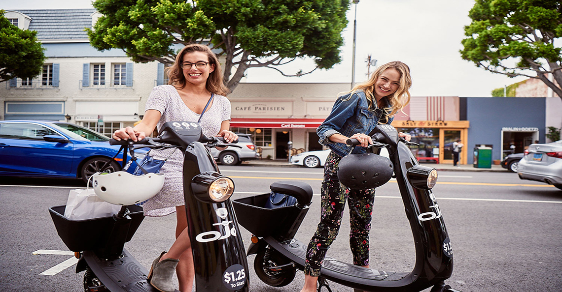 girls with ojo electric scooters