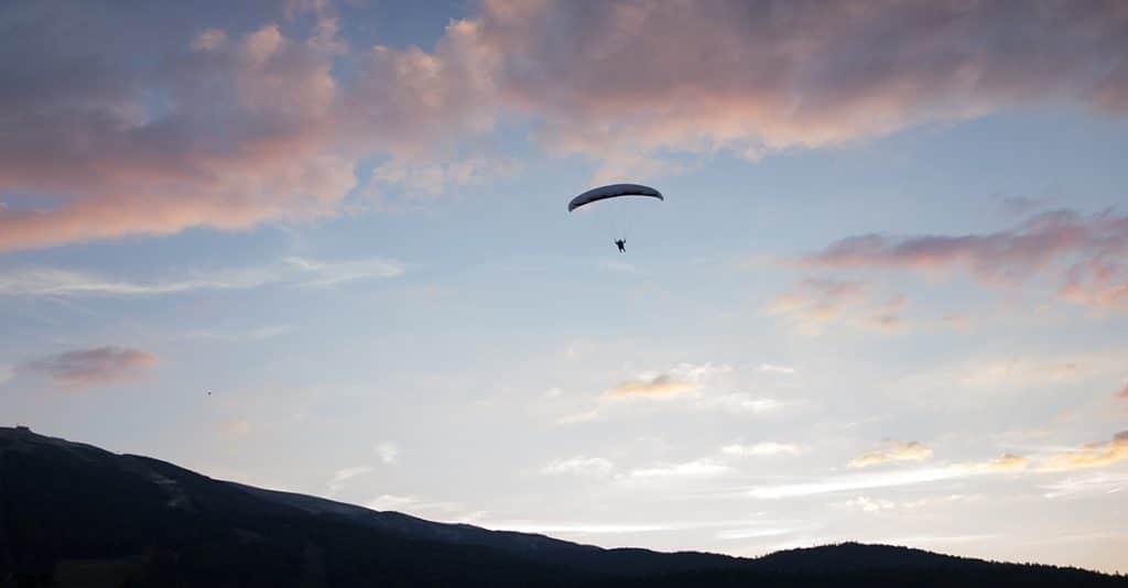 man gliding into the horizon