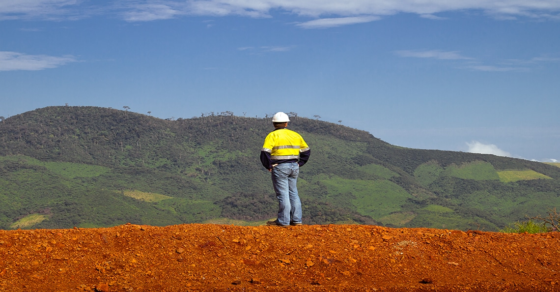 mining construction worker standing on a hill