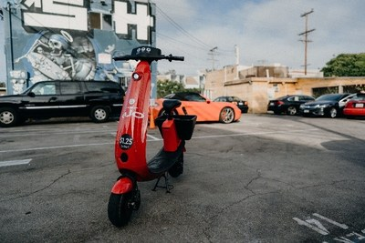 OjO V2 electric scooter model in a parking lot