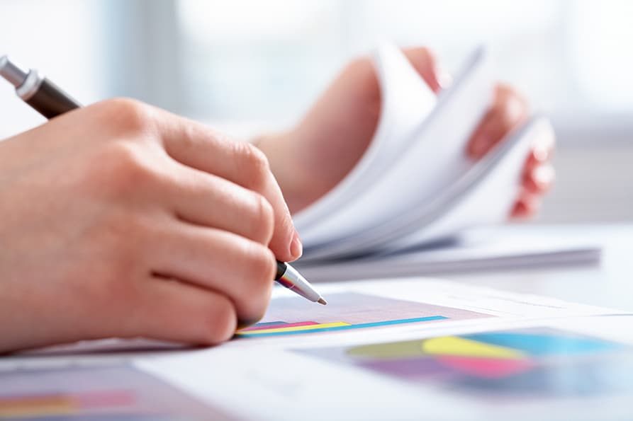 person writing a report