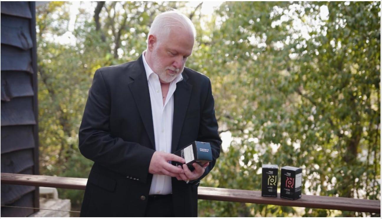 David Kerbel looking at Rritual products