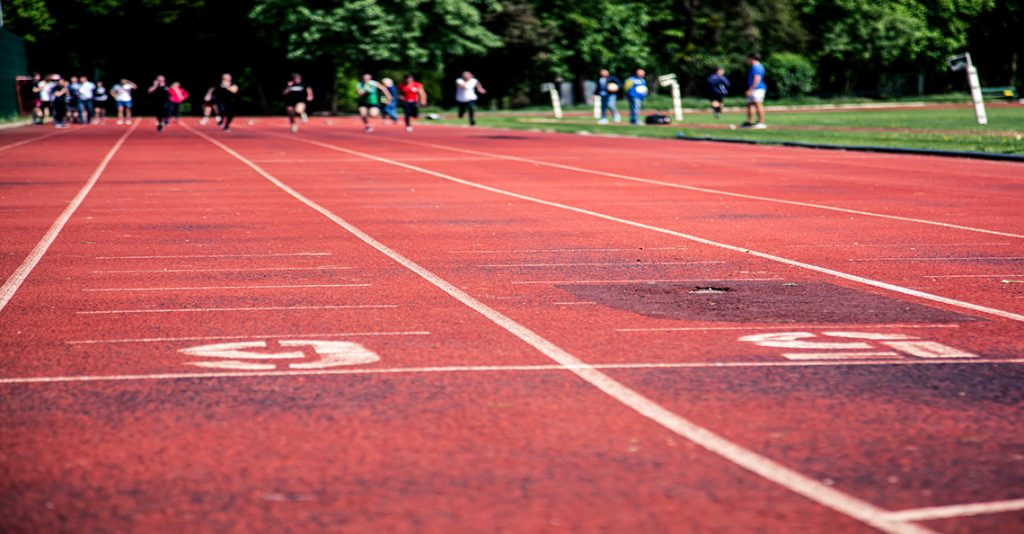 track and field course with runners