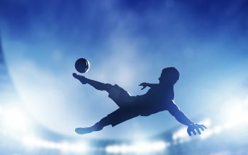 soccer player shooting on net