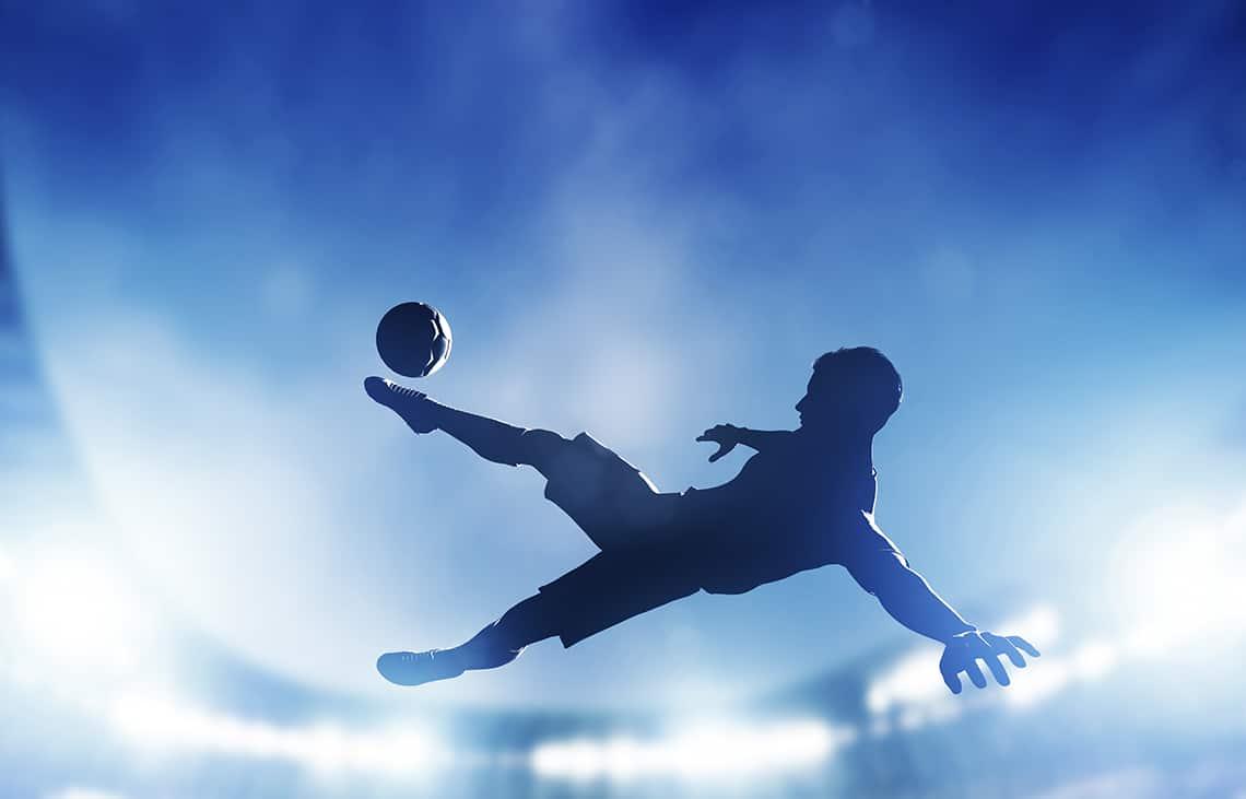 soccer player shooting on net