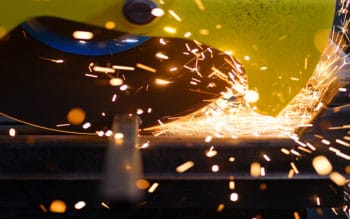 A steel sheet being cut at a steel production facility