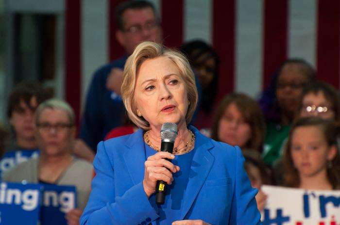 Hillary Clinton campaigns amidst record low interest rates